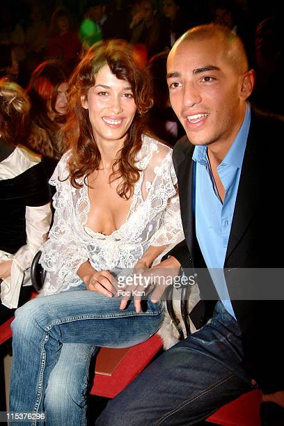 Dolores Chaplin with Boyfriend during Paris Fashion Week Ready To Wear Spring/Summer 2005 Valentino Front Row at Carrousel Du Louvre in Paris France