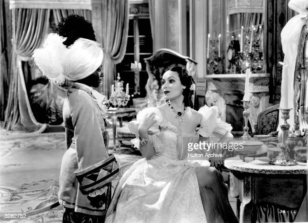 Dolores Del Rio the stage name of Dolores Asunsolo, the aristocratic Mexican leading lady talks to her black manservant in a scene from the film...