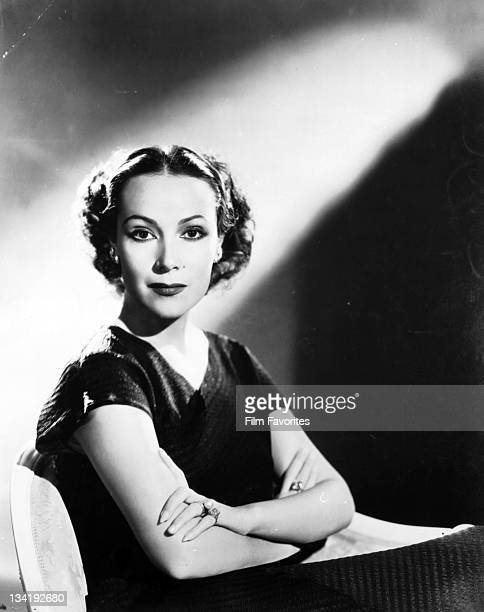 Dolores Del Rio with arms folded, 1940s.