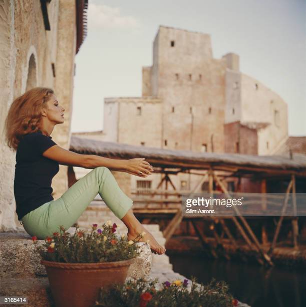 Dolores Guinness catches the sun's last rays in Costa Smerelda Sardinia