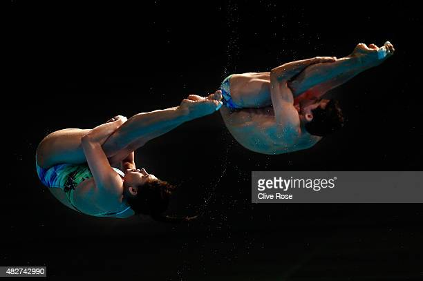 Dolores Hernandez Monzon and Rommel A Pacheco Marrufo of Mexico compete in the 3m Springboard Synchronised Mixed Diving Final on day nine of the 16th...