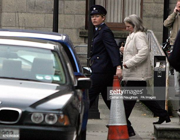 Dolores O'Neill is led away from the Central Criminal Court after being sentenced to eight years for the manslaughter of her husband Declan aged 46...