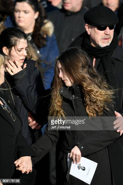 Dolores O'Riordan's exhusband Don Burton and two duaghters Taylor and Mollyattends the funeral of Dolores O'Riordan at St Ailbe's parish church in...