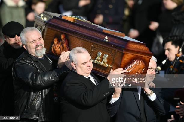 Dolores O'Riordan's exhusband Don Burton helps carry the coffin of Dolores O'Riordan out of St Ailbe's parish church in Ballybricken after the...
