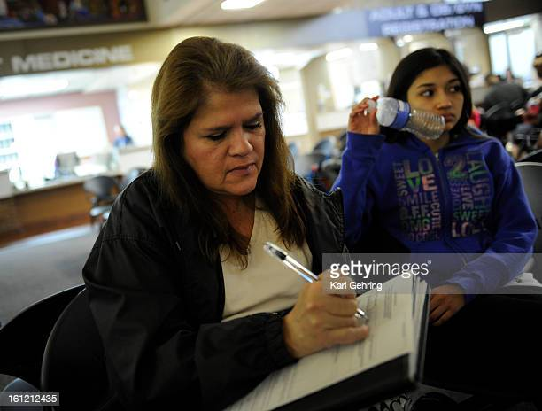 Dolores Rodriguez waited to pick up prescriptions at the Westside Family Health Center Pharmacy Wednesday January 4 2012 with her granddaughter...