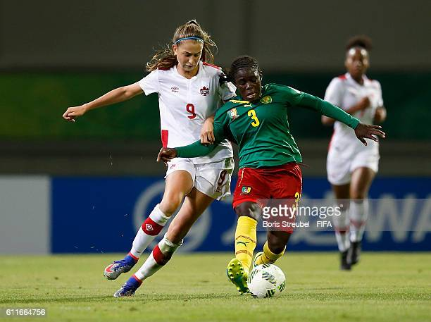 Dolores Tsadjia of Cameroon battles for the ball with Jordyn Huitema of Canada during the FIFA U17 Women's World Cup Group B match between Cameroon...