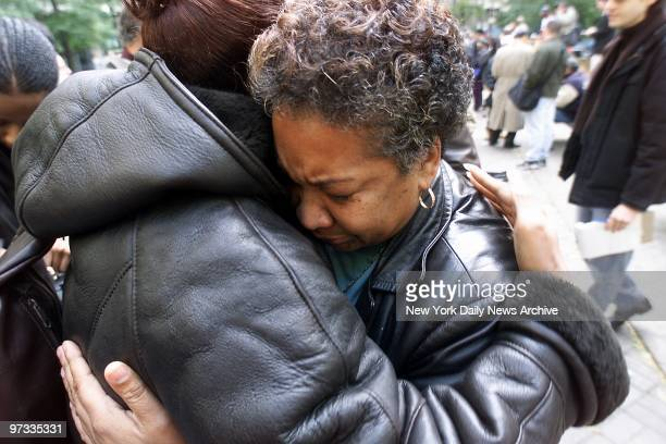 Dolores Wise the mother of Kharey Wise one of the five youths convicted in the 1989 Central Park jogger rape case is comforted at a rally outside...