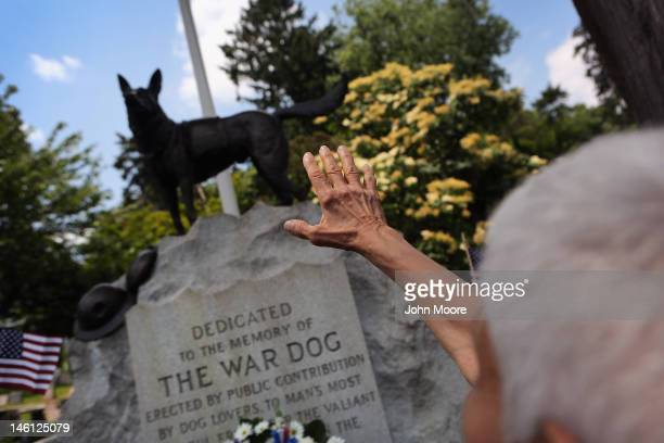Doloris Speyer pays respects during an annual memorial service for military working dogs at the Hartsdale Pet Cemetery on June 10 2012 in Hartsdale...