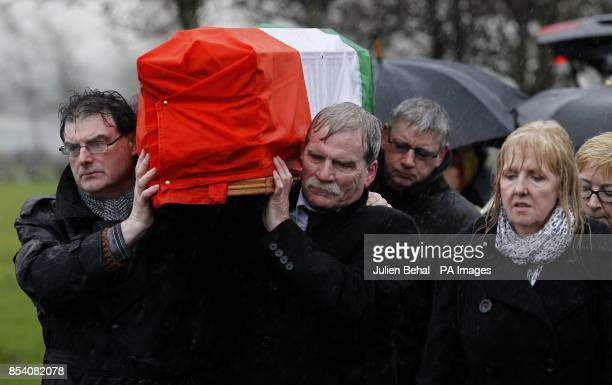 Dolours Price's coffin is carried from St Agnes Church to burial in Milltown Cemetery by Noel O'Reilly and Gerry McGlinchey husband of Marian Price...