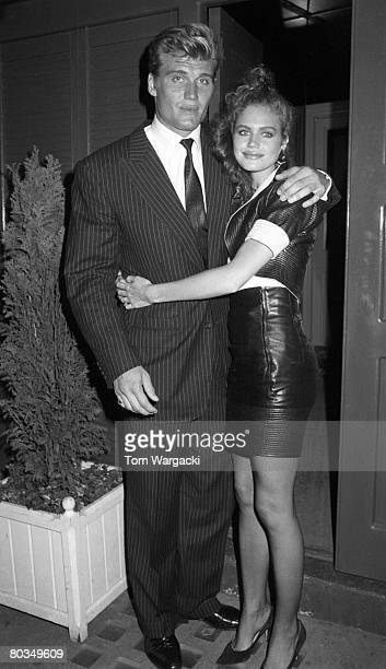 Dolph Lundgren and girlfriend Paula Barbieri leave Browns Club on June 4 1988 in London England