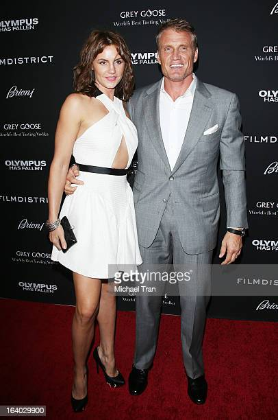 Dolph Lundgren and guest arrive at the Los Angeles premiere of 'Olympus Has Fallen' held at ArcLight Cinemas Cinerama Dome on March 18 2013 in...