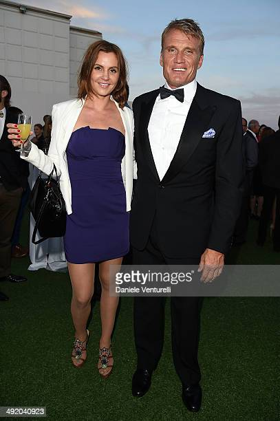 Dolph Lundgren and Jenny Sandersson attend the Expendables 3 Dinner and Party sponsored by MATCHLESS on May 18 2014 in Cannes France