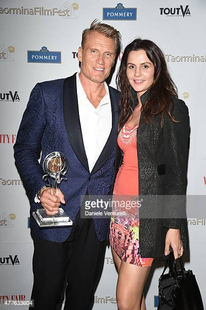 Dolph Lundgren and Jenny Sandersson attend the Vanity Fair and Pommery Gala Dinner 61st Taormina Film Fest on June 18 2015 in Taormina Italy