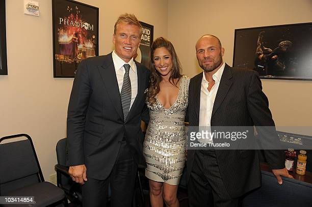 Dolph Lundgren Giselle Itie and Randy Couture attend the preparty for the special screening of The Expendables at Planet Hollywood Resort Casino on...