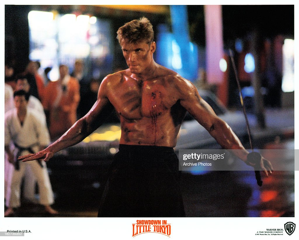 Dolph Lundgren holding sword in lobby card for the film 'Showdown In...  News Photo - Getty Images