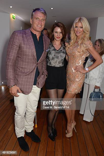 Dolph Lundgren Jenny Sandersson and Victoria Silvstedt attend the Vanity Fair And Armani Party at the 67th Annual Cannes Film Festival on May 17 2014...