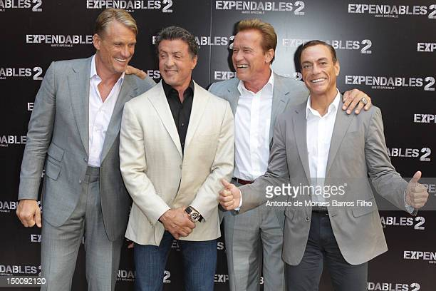 Dolph Lundgren Sylvester Stallone Arnold Schwarzenegger and JeanClaude Van Damme attend 'The Expendables 2' Photocall at Hotel George V on August 10...