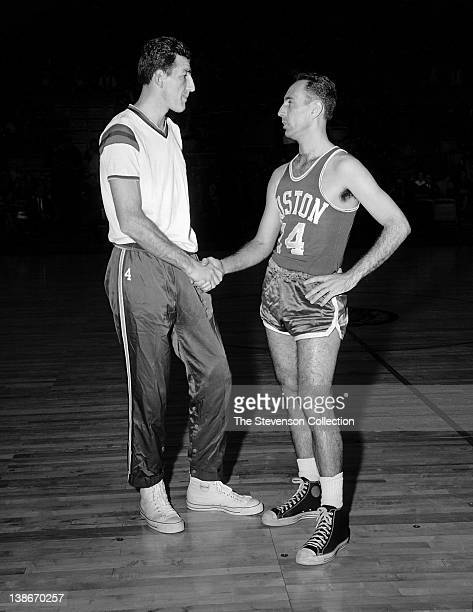 Dolph Schayes of the Syracuse Nationals shakes hands with Bob Cousy of the Boston Celtics on January 20 1963 at the Onondaga War Memorial Arena in...