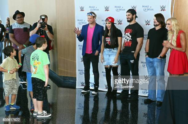 Dolph Ziggler Nikki Bella Seth Rollins AJ Styles and Dana Warrior surprise wish kids at the WWE Superstars Surprise MakeAWish Families at One World...