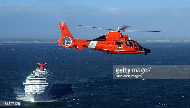 a mh-65c dolphin helicopter off the coast of san pedro, california. - coast guard stock pictures, royalty-free photos & images