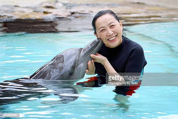 Dolphin kiss a woman