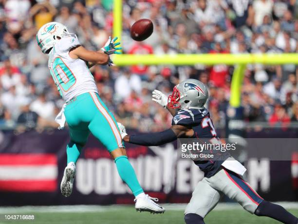 Dolphins Danny Amendola attempts to catch the ball against Patriots Jonathan Jones in the first quarter Amendola missed the catch New England...