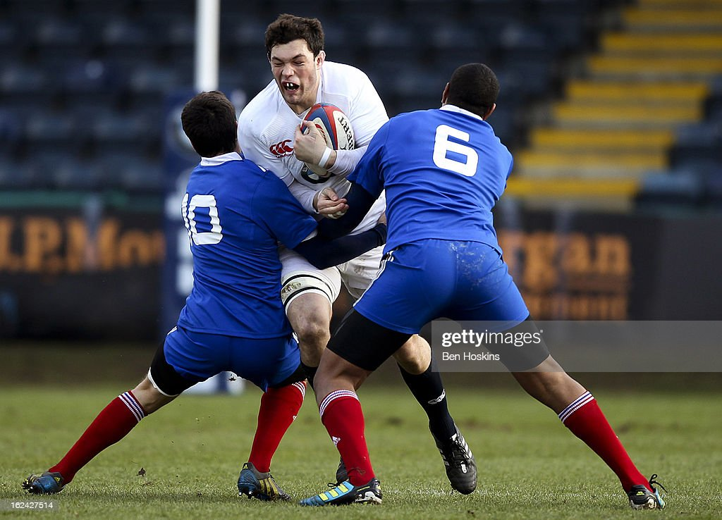 Dom Barrow of England is tackled by Vincent Mallet (L) and Mathieu Babillot (R) of France during the U20s RBS Six Nations match between England U20 and France U20 at the Sixways Stadium on February 23, 2013 in Worcester, England.