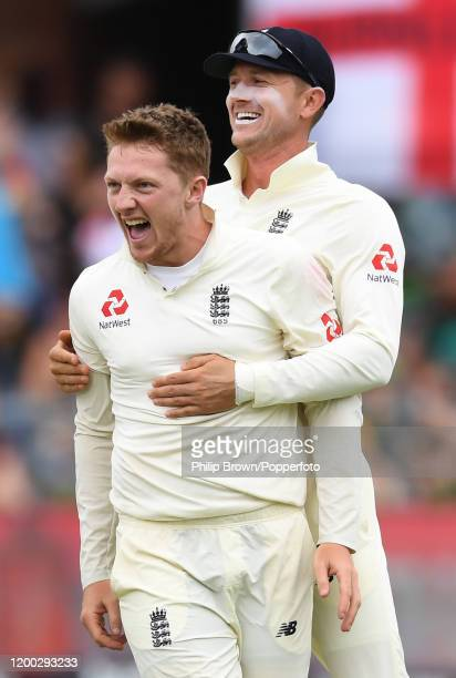 Dom Bess and Joe Denly of England celebrate after the dismissal of Faf du Plessis of South Africa during Day Three of the Third Test between England...