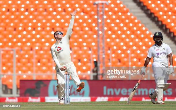 Dom Bess of England bowls watched on by Rishabh Pant of India during Day Two of the 4th Test Match between India and England at Sardar Patel Stadium...
