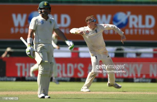 Dom Bess of England celebrates after dismissing Dean Elgar of South Africa during Day Two of the Second Test between England and South Africa on...