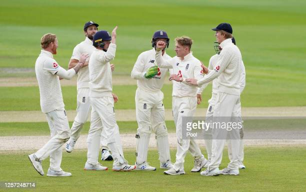 Dom Bess of England celebrates the wicket of Jason Holder of West Indies with teammates during Day Five of the 2nd Test Match in the #RaiseTheBat...