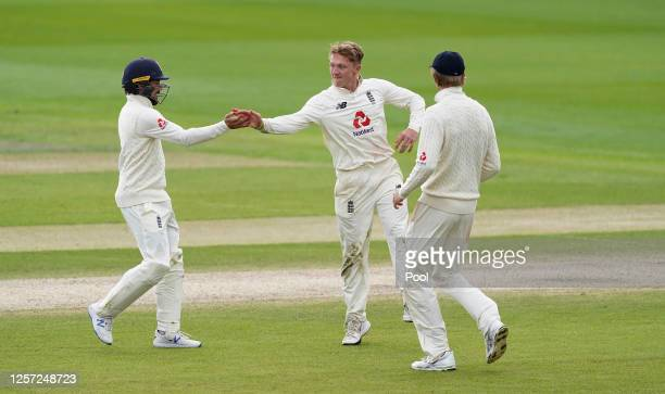 Dom Bess of England celebrates the wicket of Jason Holder of West Indies with Rory Burns during Day Five of the 2nd Test Match in the #RaiseTheBat...