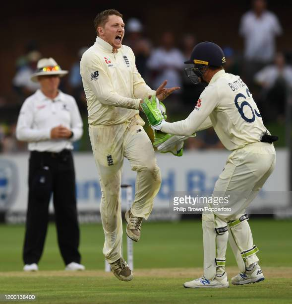 Dom Bess of England celebrates with Jos Buttler after the dismissal of Zubayr Hamza of South Africa during Day Two of the Third Test between England...