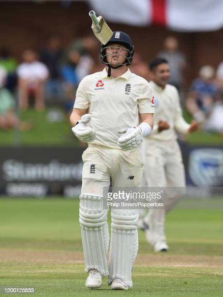 Dom Bess of England leaves the field after being dismissed during Day Two of the Third Test between England and South Africa on January 17, 2020 in...