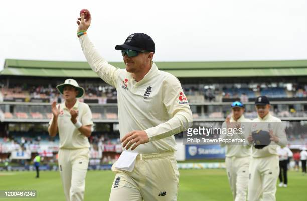Dom Bess of England leaves the field holding up the ball after taking five wickets during Day Four of the Third Test between England and South Africa...