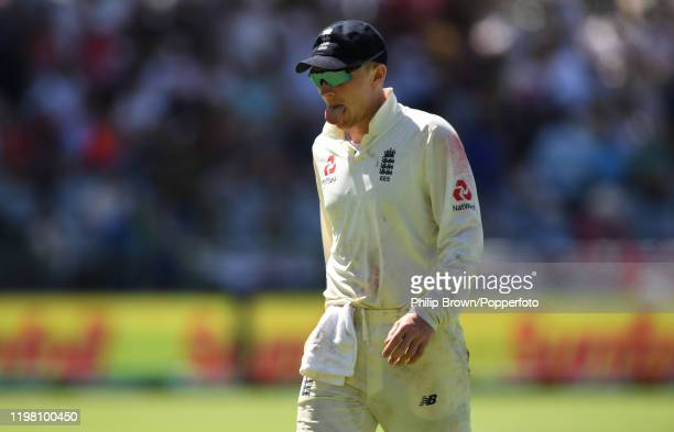 Dom Bess of England pokes out his tongue during Day Five of the Second Test between England and South Africa at Newlands on January 07, 2020 in Cape...
