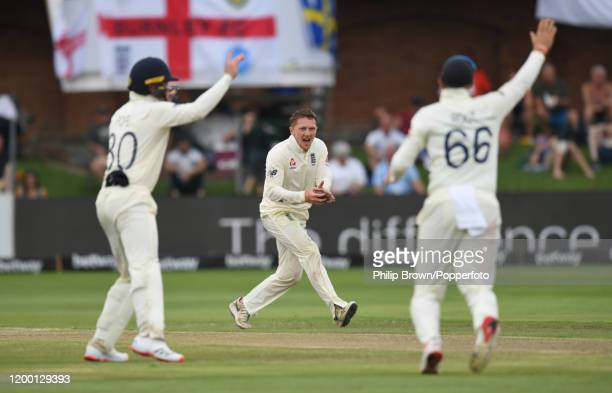 Dom Bess of England reacts after catching Pieter Malan of South Africa during Day Two of the Third Test between England and South Africa on January...