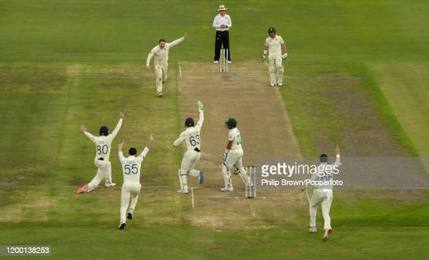Dom Bess of England reacts after Zubayr Hamza of South Africa was caught by Ollie Pope during Day Two of the Third Test between England and South...