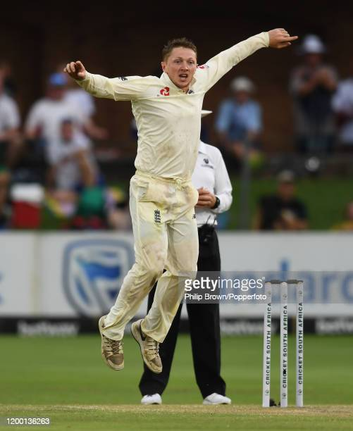 Dom Bess of England reacts as Zubayr Hamza of South Africa is caught during Day Two of the Third Test between England and South Africa on January 17,...