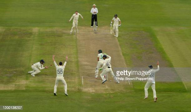 Dom Bess of England reacts as Zubayr Hamza of South Africa is caught by Ollie Pope during Day Two of the Third Test between England and South Africa...