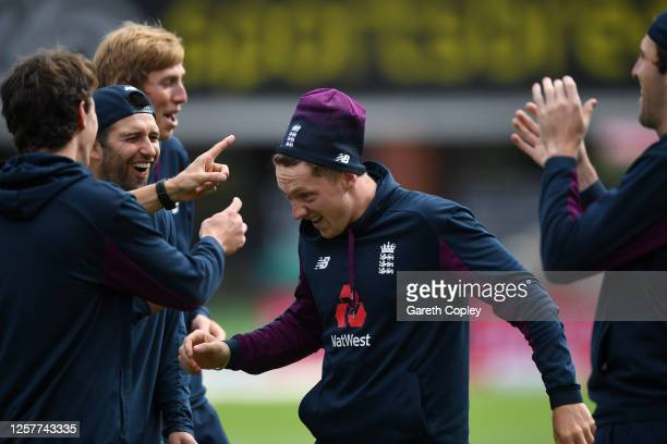 Dom Bess of England shares a joke with Zak Crawley Dan Lawrence and Craig Overton during a England Nets Session at Emirates Old Trafford on July 23...