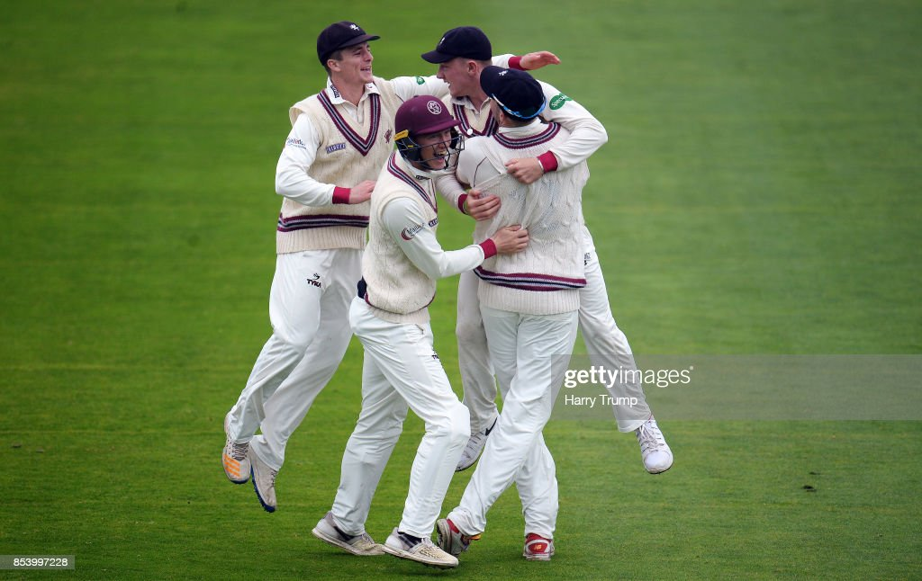 Dom Bess of Somerset(2R) celebrates after running out John Simpson of Middlesex during Day Two of the Specsavers County Championship Division One match between Somerset and Middlesex at The Cooper Associates County Ground on September 26, 2017 in Taunton, England.