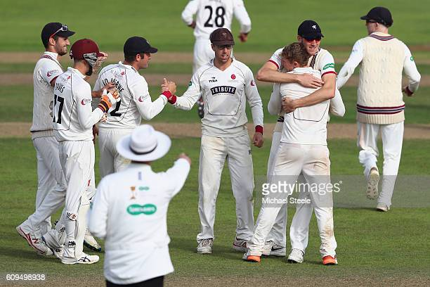 Dom Bess of Somerset is hugged by Craig Overton after he took his fifth wicket to finish with figures of 5 for43 during day two of the Specsavers...