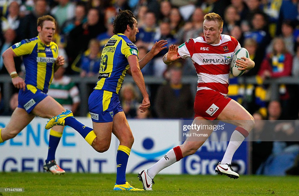 Dom Crosby of Wigan (R) in action with Stefan Ratchford of Warrington during the Super League match between Warrington Wolves and Wigan Warriors at the Halliwell Jones Stadium on June 24, 2013 in Warrington, England.
