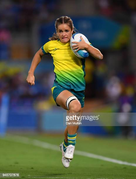 Dom du Toit of Australia makes a break during the Rugby Sevens Women's Pool B match between Australia and Wales on day nine of the Gold Coast 2018...