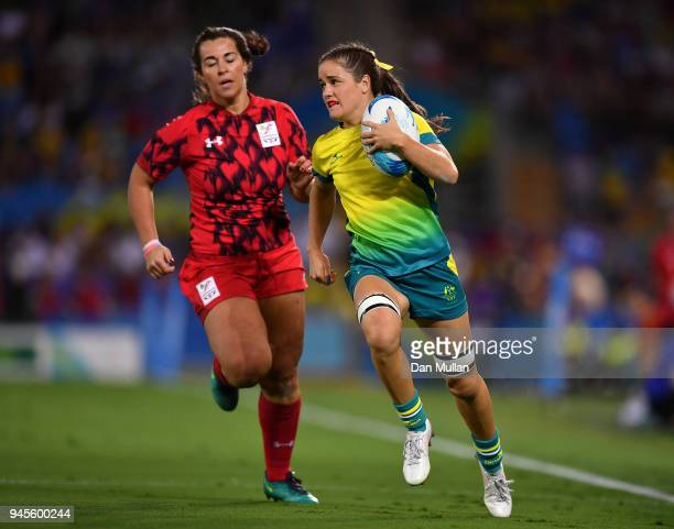 Dom du Toit of Australia makes a break past Shona PowellHughes of Wales during the Rugby Sevens Women's Pool B match between Australia and Wales on...