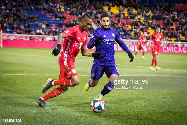 Dom Dwyer of Orlando City and Amro Tarek of New York Red Bulls make a play for the ball during the MLS match between Orlando City SC and New York Red...