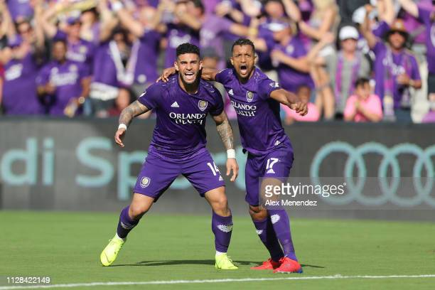 Dom Dwyer of Orlando City and Nani of Orlando City celebrate the tying goal during a MLS soccer match against New York City FC at Orlando City...