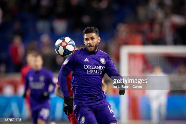 Dom Dwyer of Orlando City keeps the ball in front of him during the MLS match between Orlando City SC and New York Red Bulls at Red Bull Arena on...