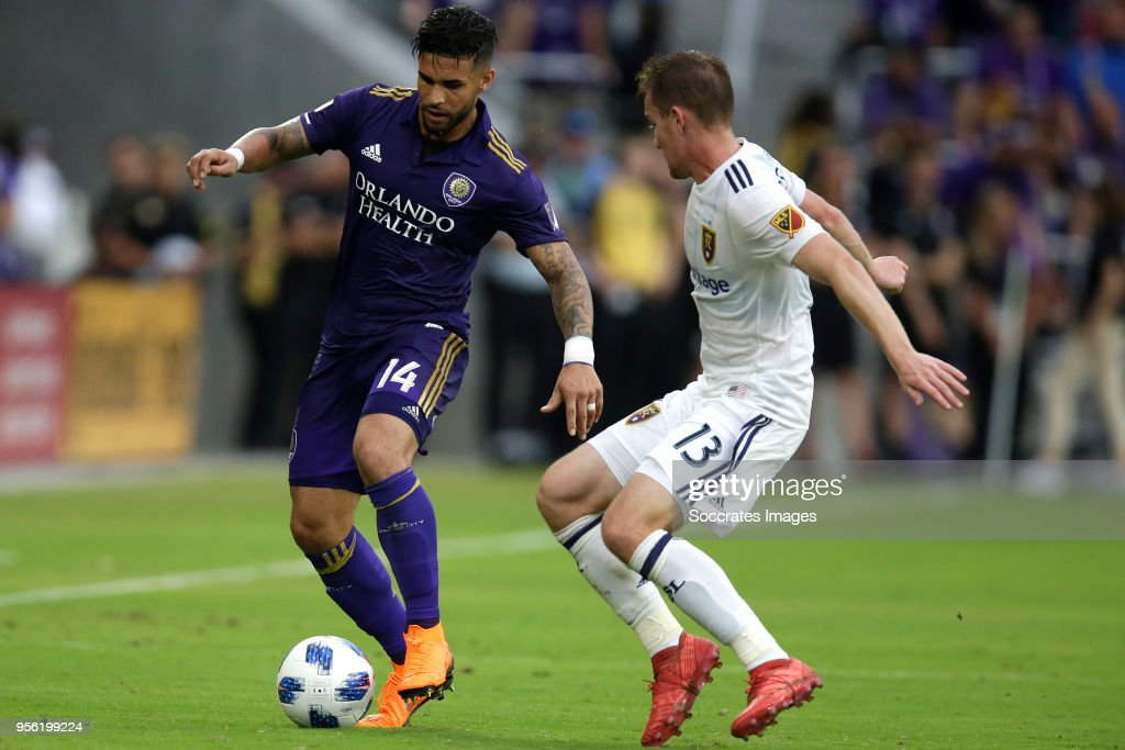 Dom Dwyer of Orlando City , Nick Besler of Real Salt Lake during the match between Orlando City v Real Salt Lake on May 6, 2018